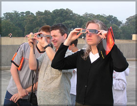 Figure 1 - People using solar viewing glasses to safely view the Sun
