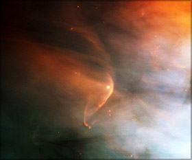 Bow shock, about half a light-year across, created from the wind from the star L.L. Orionis colliding with the Orion Nebula flow